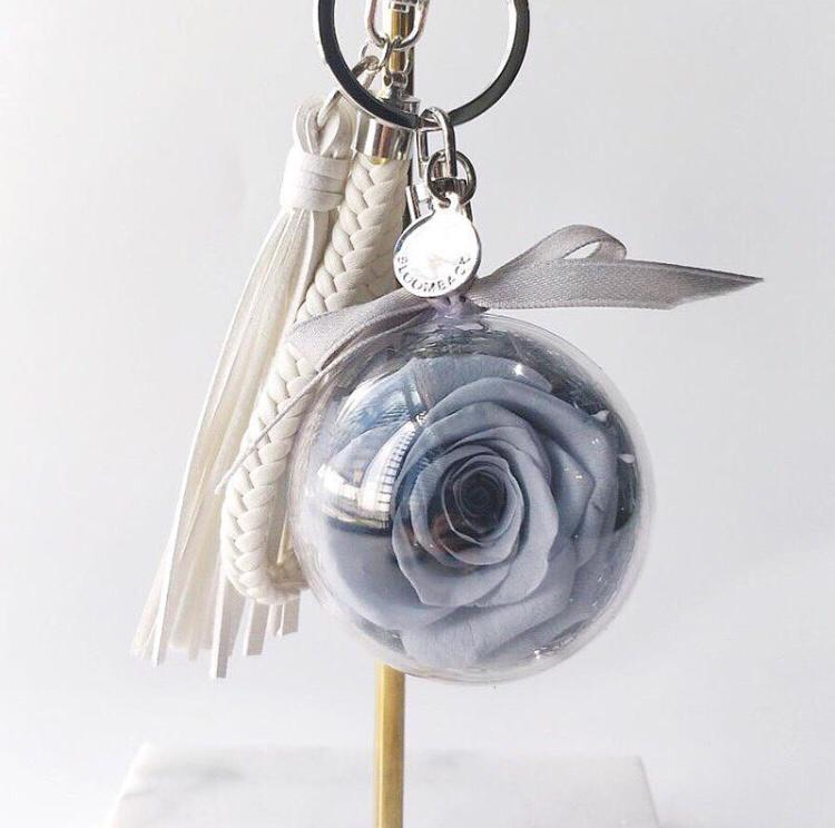 Bag charm featuring space grey preserved rose in acrylic ball