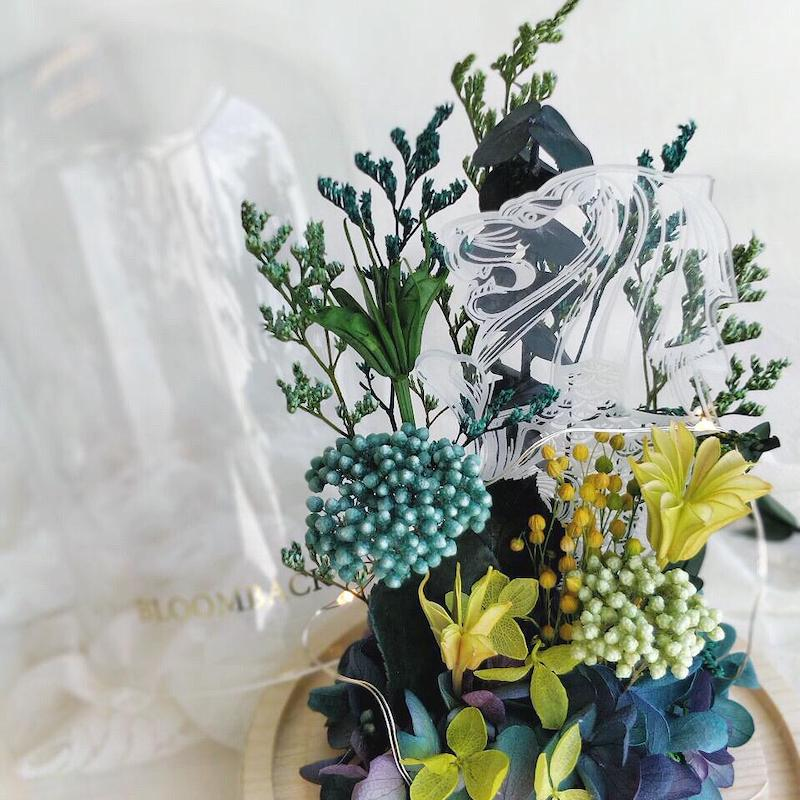 A medium glass dome featuring green and purple hydrangeas, preserved foliages, 1 Merlion acrylic display and LED lights.