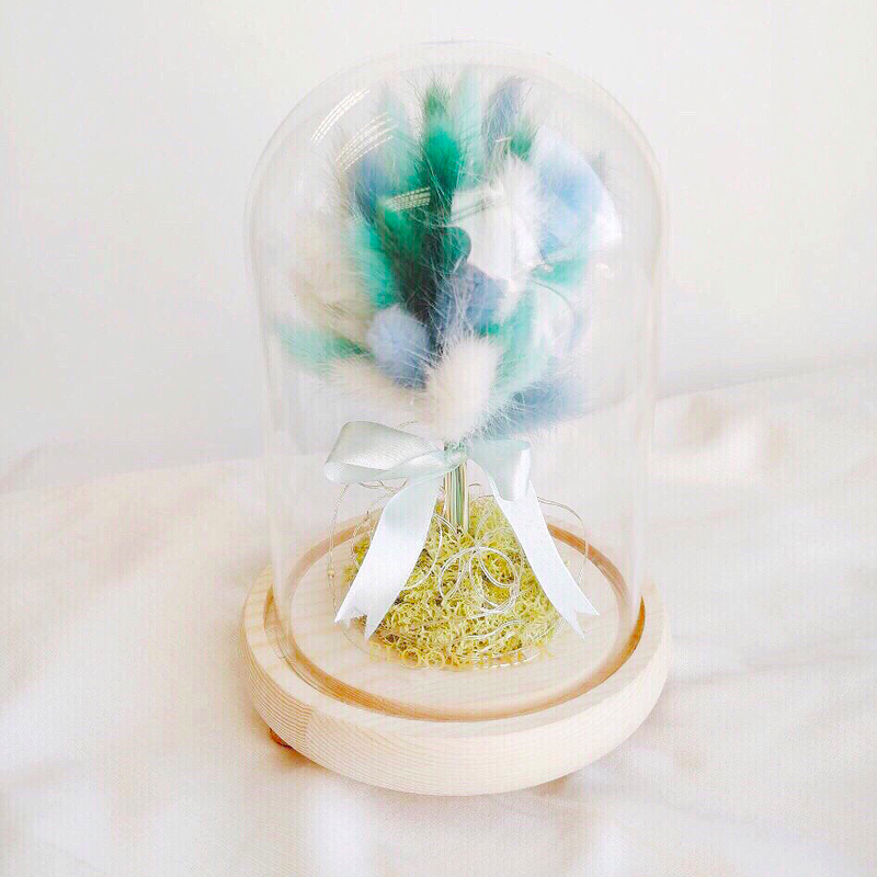 Wishing Tree crafted with various bunny tails in blue, turquoise and white in glass dome