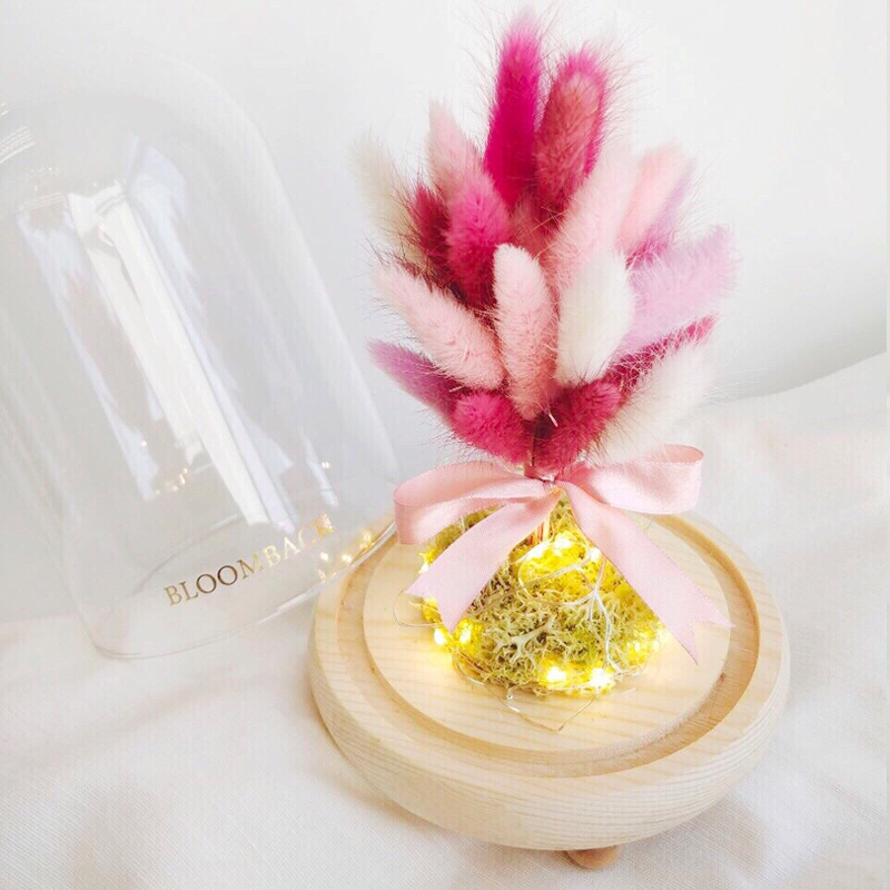 Wishing Tree crafted with various bunny tails in light pink, dark pink and fuschia in glass dome