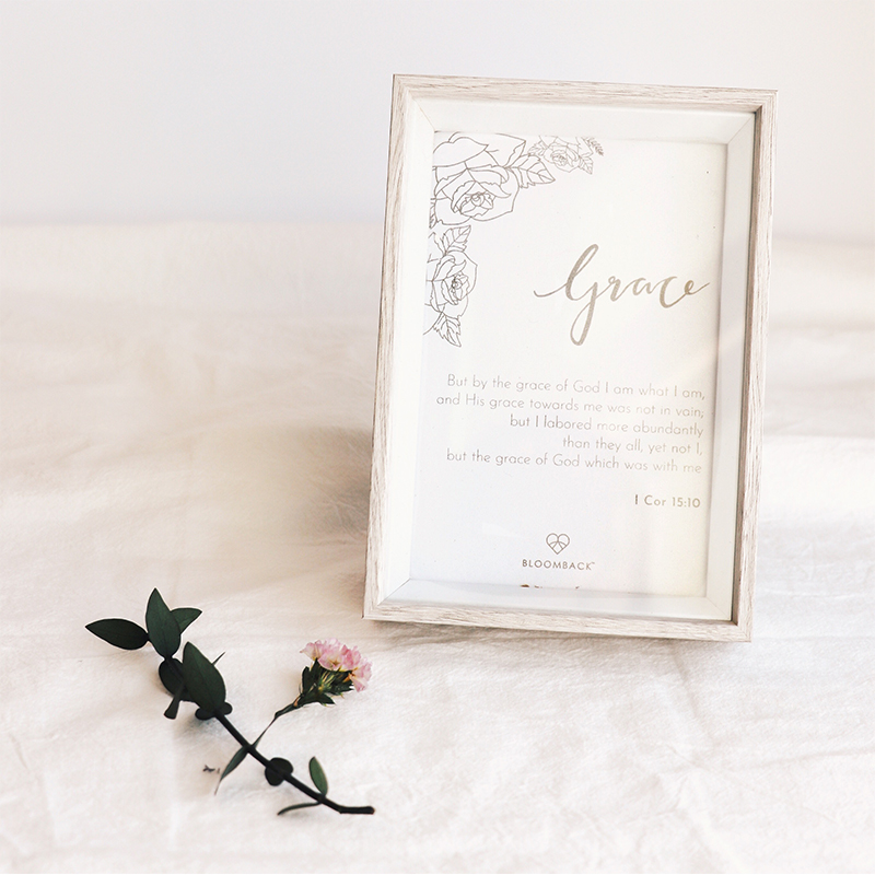 Card with inspirational message in wooden photo frame